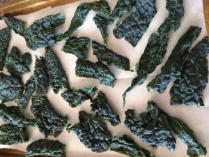 I have found that the kale chips bake the best on a parchment paper lined cookie sheet!