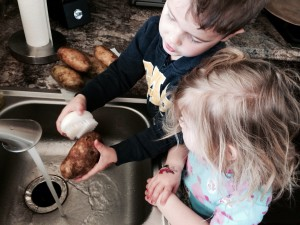 My little helpers love scrubbing the potatoes! Get the kids get involved! They will eat it because they made it!