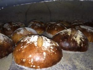 Sneak peek inside the oven!! Almost done! Jonathan taps the loaves to check their progress!