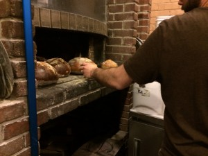 The bread is cooked from the heat retained by the wood-fired oven dishes cooked the previous evening.