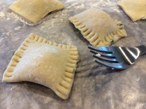Press hard so that the dough adheres and so that the ravioli wont lose their filling in the water!