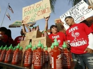 "Photo via The Washigton Times 4/23/14. Photo depicts a Sriracha demonstration in CA as residents fought to shut down the Irwindale plant because the air was ""too spicy."""